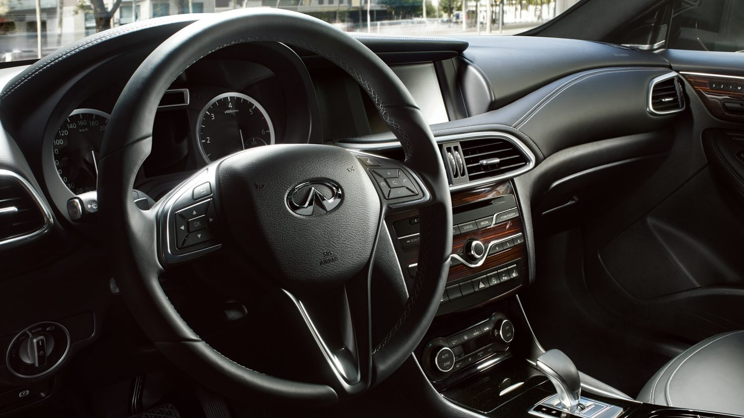 black leather steering wheel of luxury car