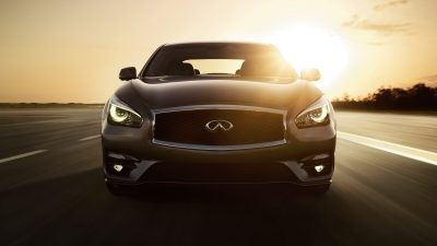 INFINITI Q70 sedan driving on a road