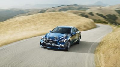 INFINITI Q50 sedan driving on a country road