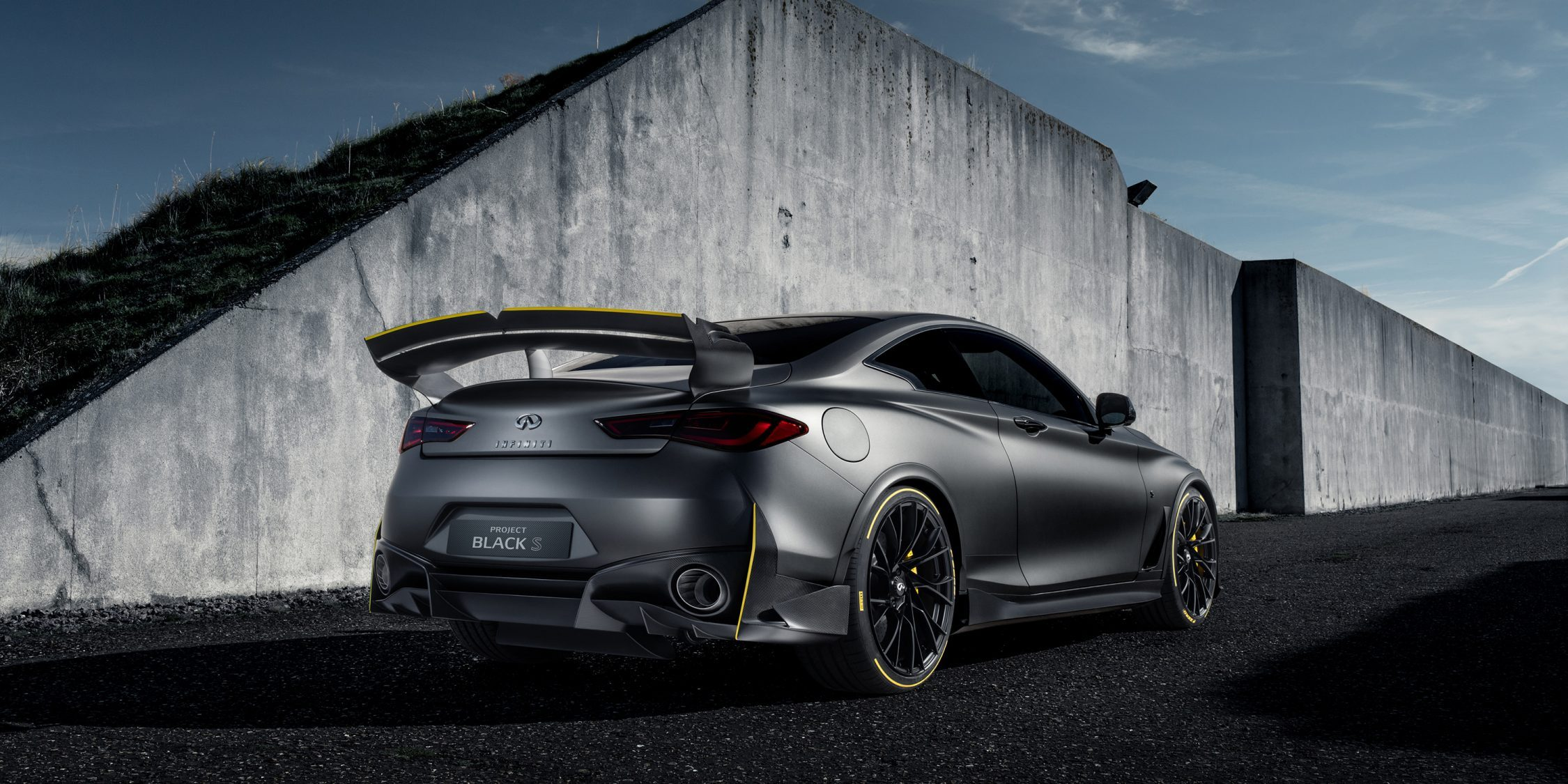 Rear of the INFINITI Project Black S high performance vehicle driving away