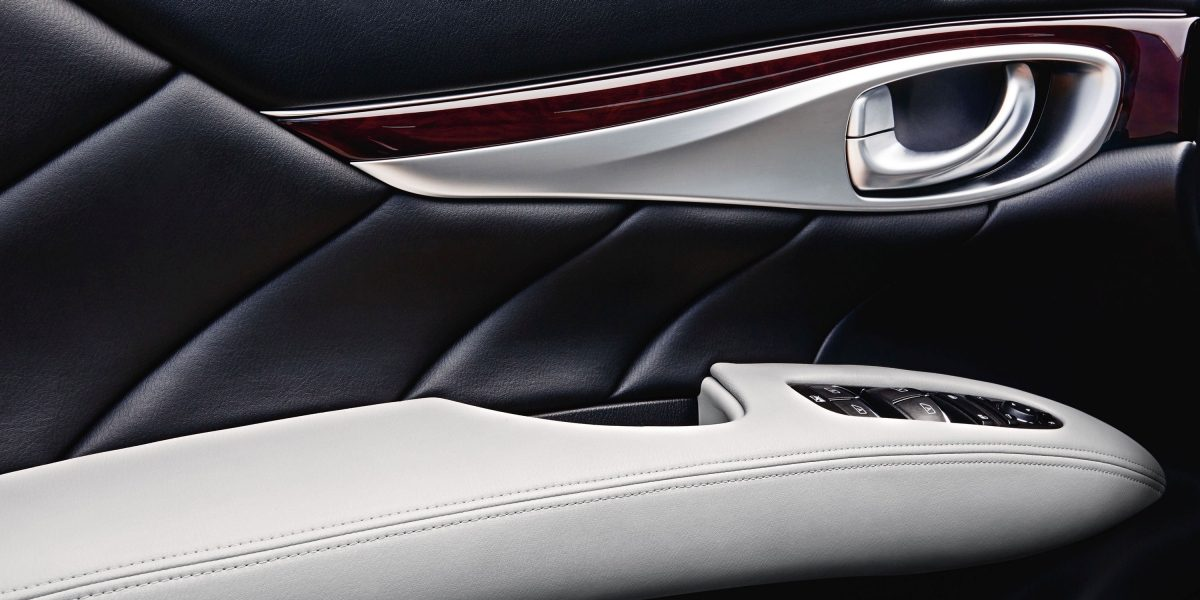 Luxury sedan interior - Door handle, wood and leather trim