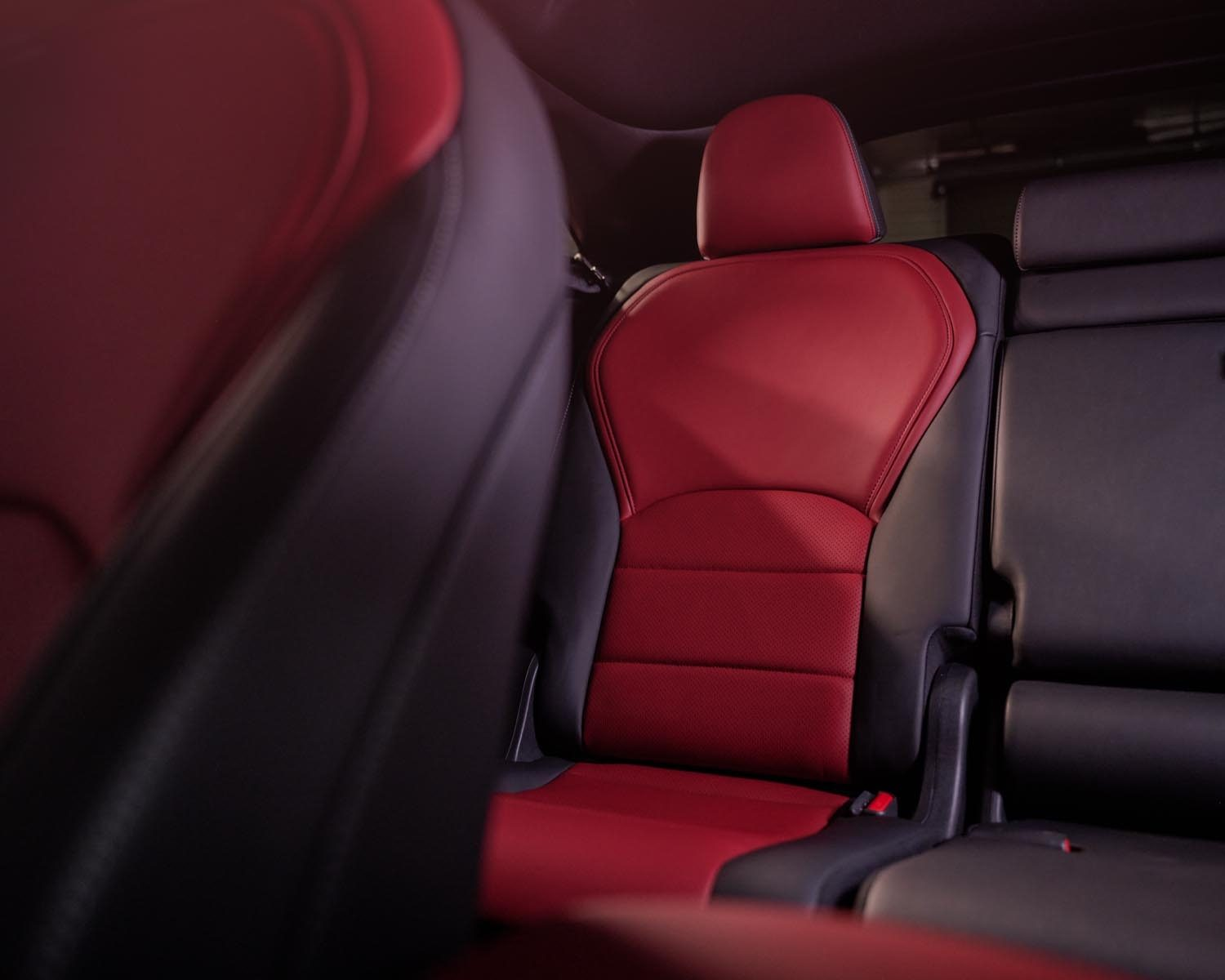 Luxurious black and red sliding second row seats with versatile cargo space | 2022 INFINITI QX55 crossover Reveal