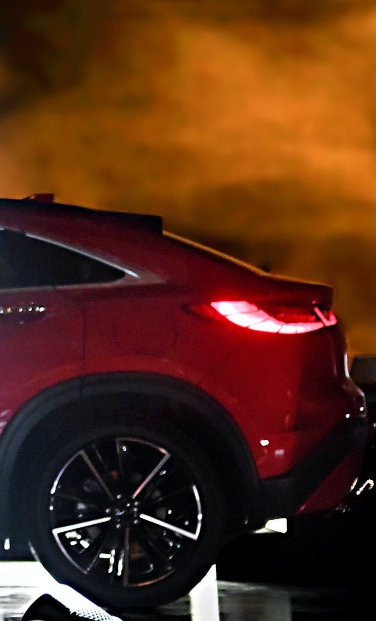 Rear and side view of a luxurious red 2022 INFINITI QX55 crossover