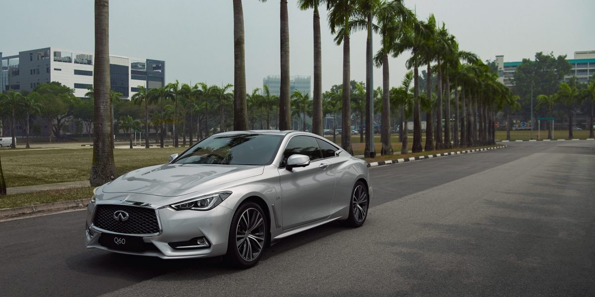 2020 INFINITI Q60 Red Sport 400 Sports Coupe Design Driving on the Road Side View