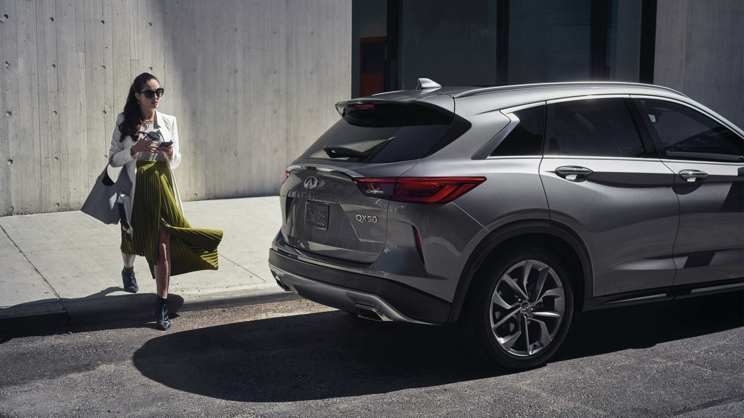 2020 INFINITI QX50 Luxury Crossover Parked Besides Female Model2020 INFINITI QX50 Luxury Crossover Parked Besides Female Model