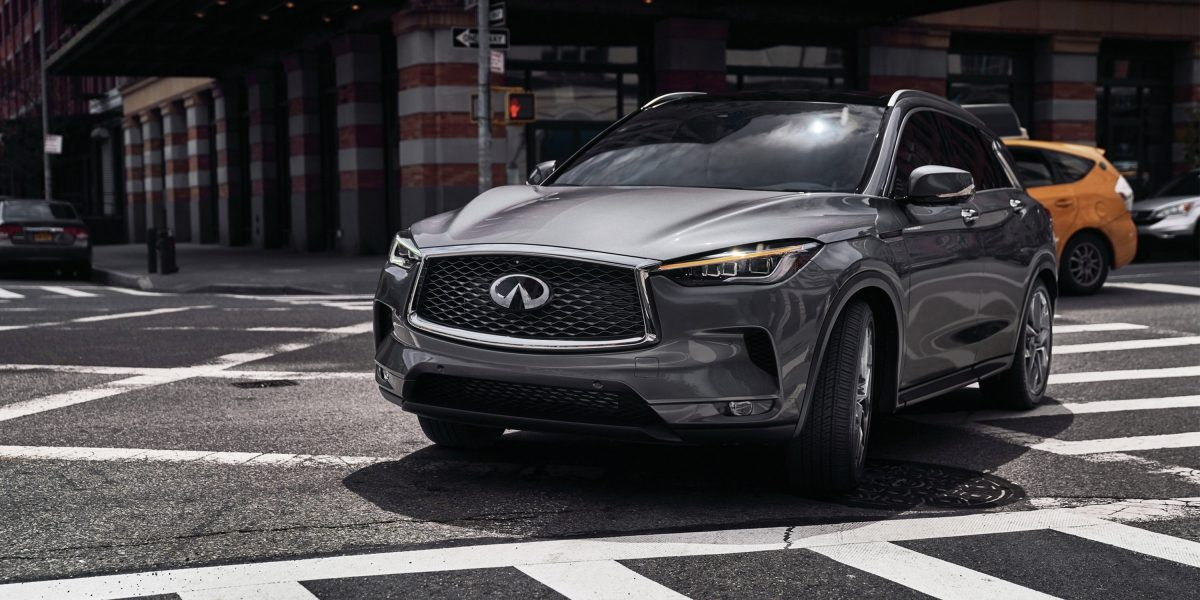 A 2020 INFINITI QX50 Luxury Crossover Turning A Corner In An Urban Area