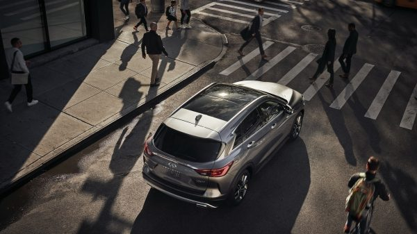 2020 INFINITI QX50 Luxury Crossover Stopped At A Pedestrian Crossing Aerial View