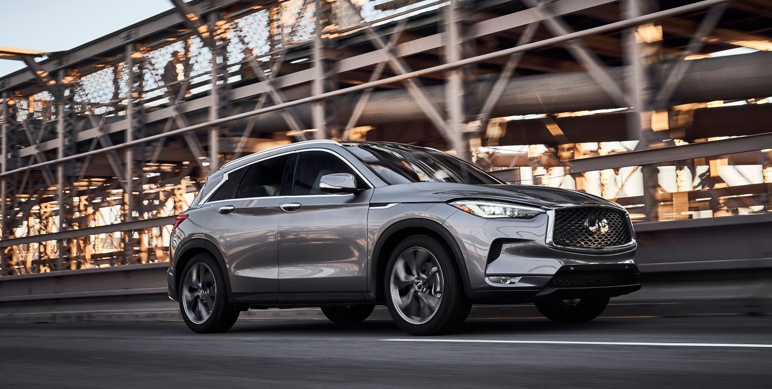 2020 INFINITI QX50 Luxury Crossover Driving On A Bridge In Wet Conditions