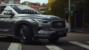 2020 INFINITI QX50 Luxury Crossover Turning On An Urban Road Thumbnail