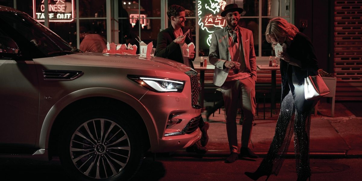 2019 INFINITI QX80 SUV Parked On Urban Road At Night