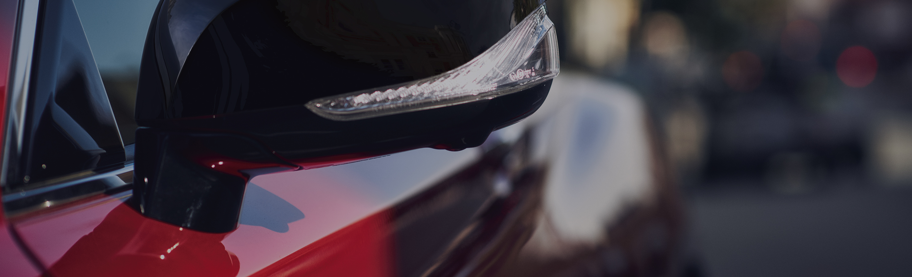 A closeup of the Q60's wing mirror