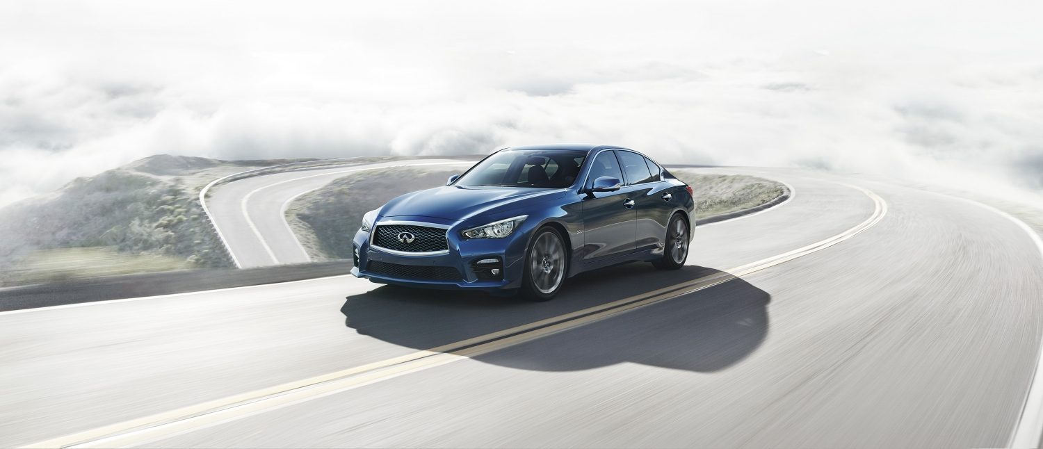 Q50 Sedan driving on a mountain road