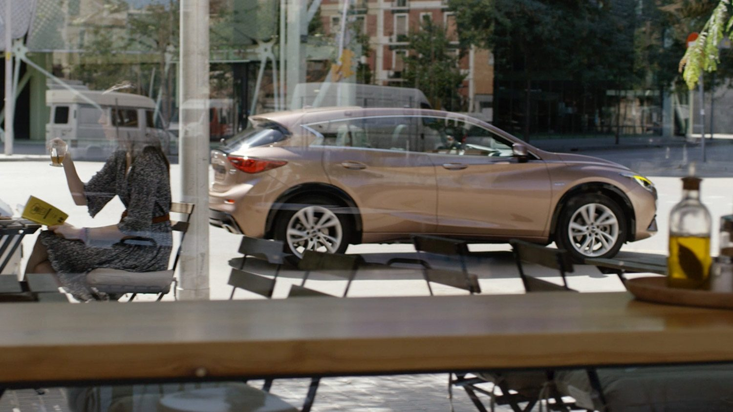 Hatchback through a cafe window
