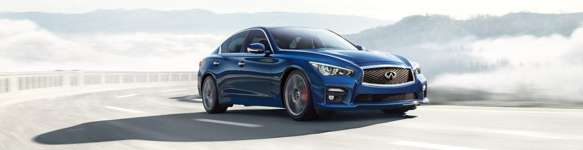 INFINITI Q50 sedan driving on a highway