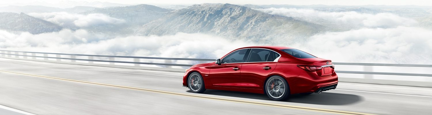 Rear Passenger's View of the 2018 INFINITI Q50 Red Sport Sedan in Dynamic Sunstone Red