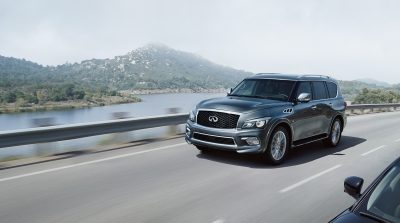 INFINITI QX80 SUV driving on corniche road