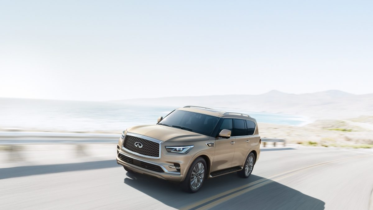 2018 INFINITI QX80 SUV on a beach road